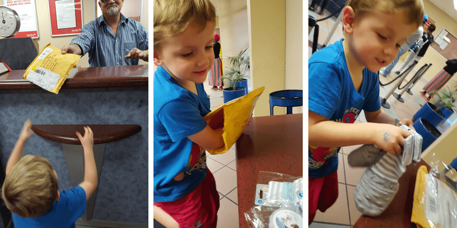 My son excitedly receiving his Handsocks