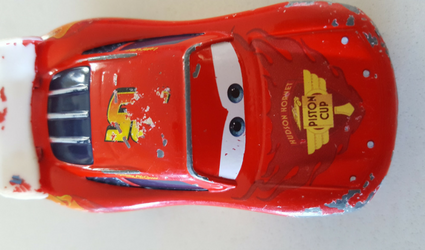Disney Pixar Lightning McQueen Diecast Car after lots of rough play. Can you tell this toy is well loved by a little boy?